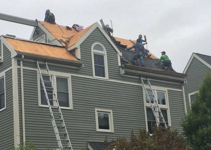 Contractors installing a new roof in Cranston.